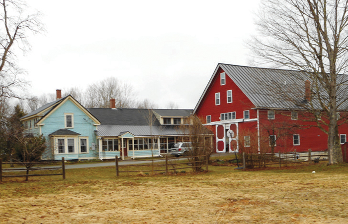Our former farm in Maine. The house, carriage shed and barn run east to west, capture plenty of solar energy and place a narrow face to the prevailing winds. The offset barn allows the wind to pass through, removing any odors and helping condition stored hay.